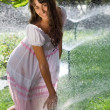 Girl with sprinklers — Stock Photo