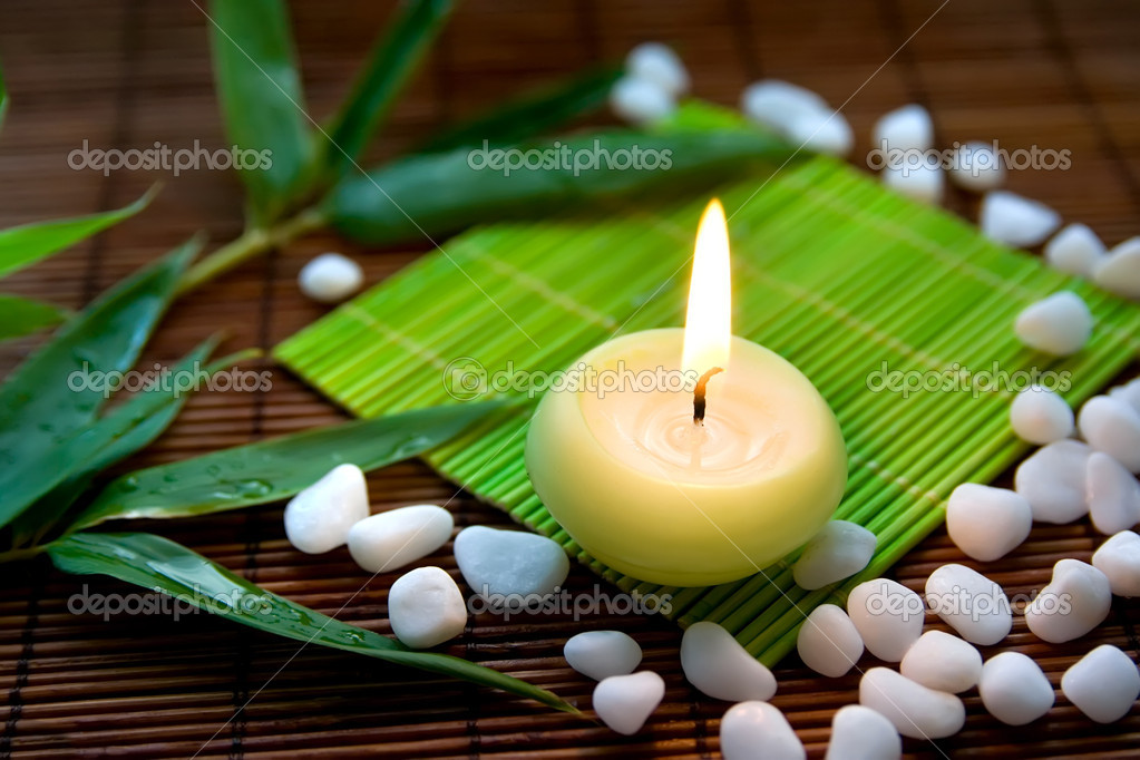 Composition with flaming candle, white  stones and bamboo leaves, symbolizing zen, calmness and meditation — Stock Photo #4032983