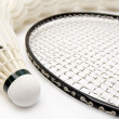 Stock Photo: Row of shuttlecocks with racket