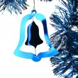 Blue shiny Christmas tinsel bell — Stock Photo