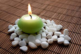 Meditation with burning candle — Стоковое фото