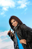 Young smiling girl and blue sky — Stock Photo