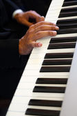 Hands of pianist — Stock Photo