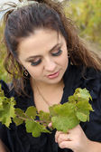 Lady with vine sprout — Stockfoto