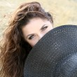Stock Photo: Young lady hiding behind bonnet