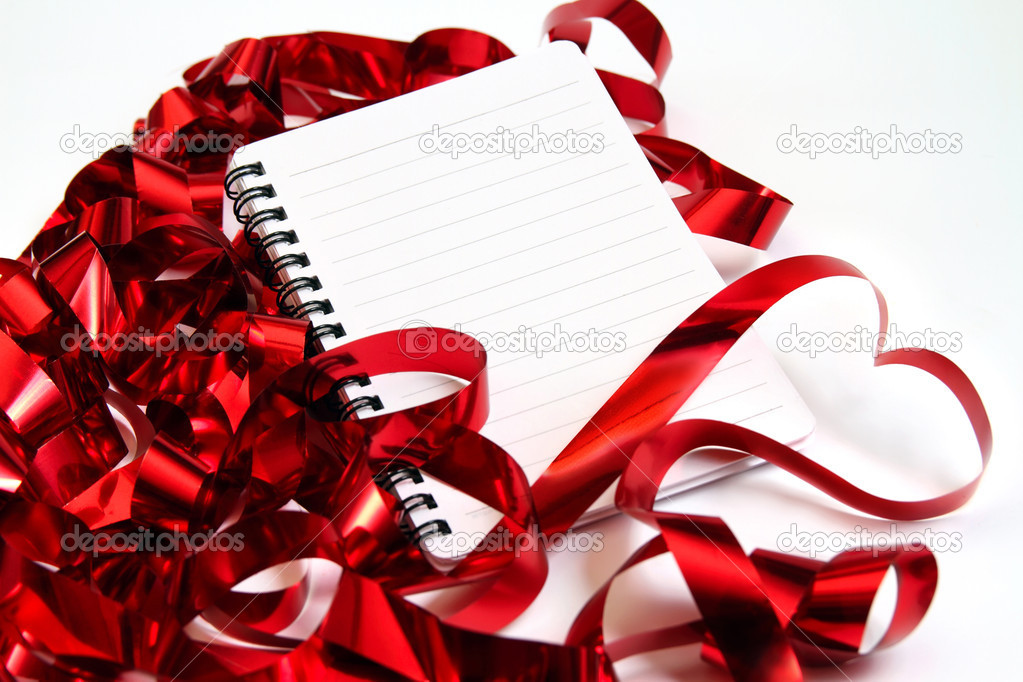 Valentine background with writing-pad and shiny red ribbons in the shape of heart — Stock Photo #4687508