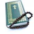 Bible and rosary beads — Stock Photo