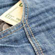 Condoms and money in pocket — Stockfoto
