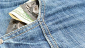 Condoms and money in pocket — Stock Photo