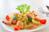 Pasta with bacon and salmon — Stock Photo