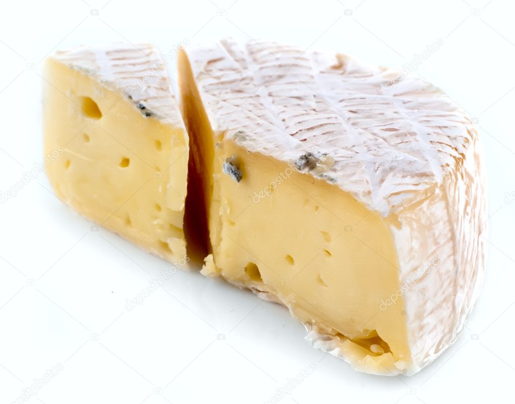 A piece of Camembert cheese on a white plate  Stock Photo #4619524