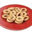 Round cracknel on red plate — Stock Photo