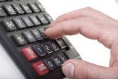 Calculator with hand macro — Stock Photo