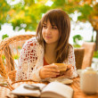 Young woman drinking tea in a cafe outdoors — Stock Photo #4086936