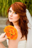 Beautiful bride with a wedding bouquet — Stock Photo