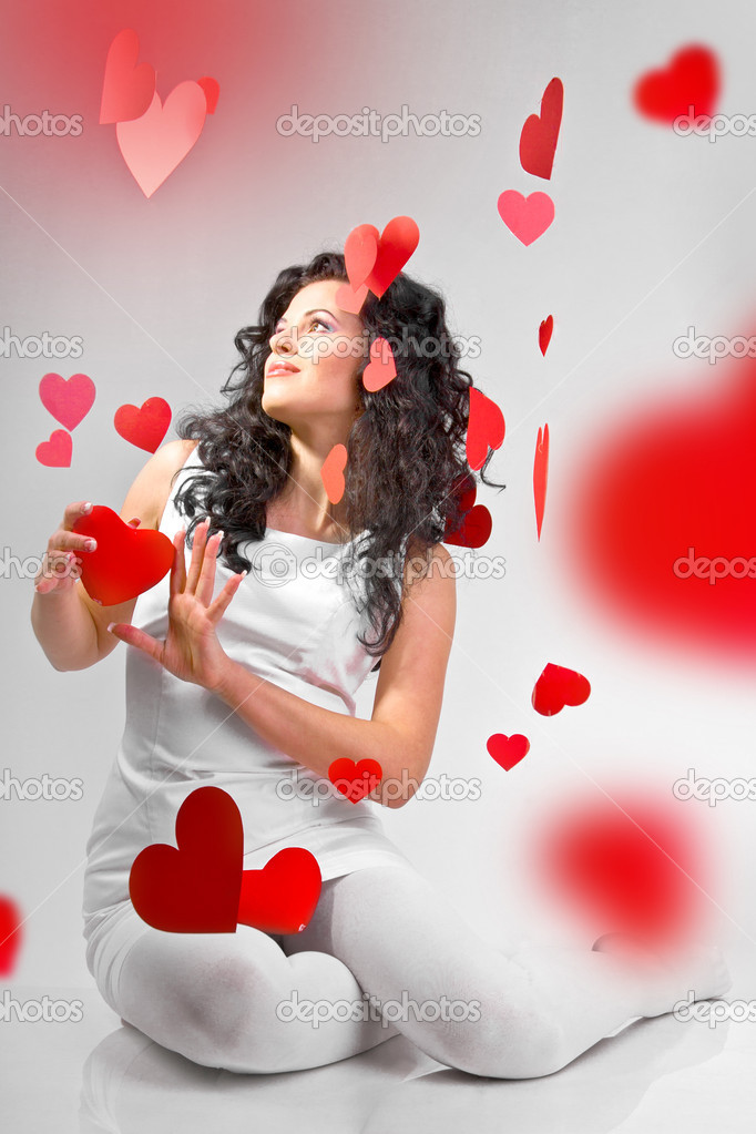 attractive smiling woman with heart on white background — Stock Photo #4675107