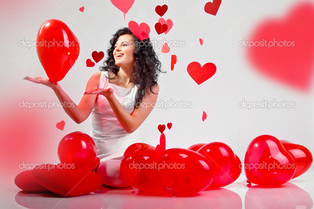 Woman with red heart balloon on a white background — Stok fotoğraf #4675120