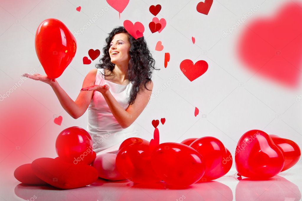 Woman with red heart balloon on a white background — Photo #4675120