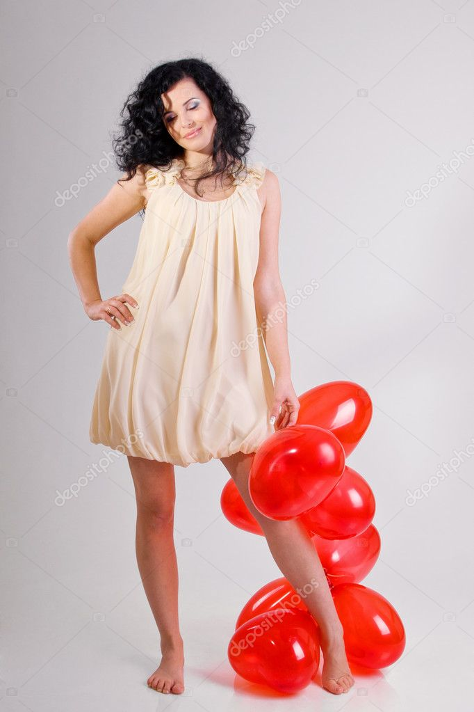 Woman with red heart balloon on a white background — Stock Photo #4675131