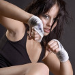 A young and fit female fighter posing in combat poses — Stock Photo