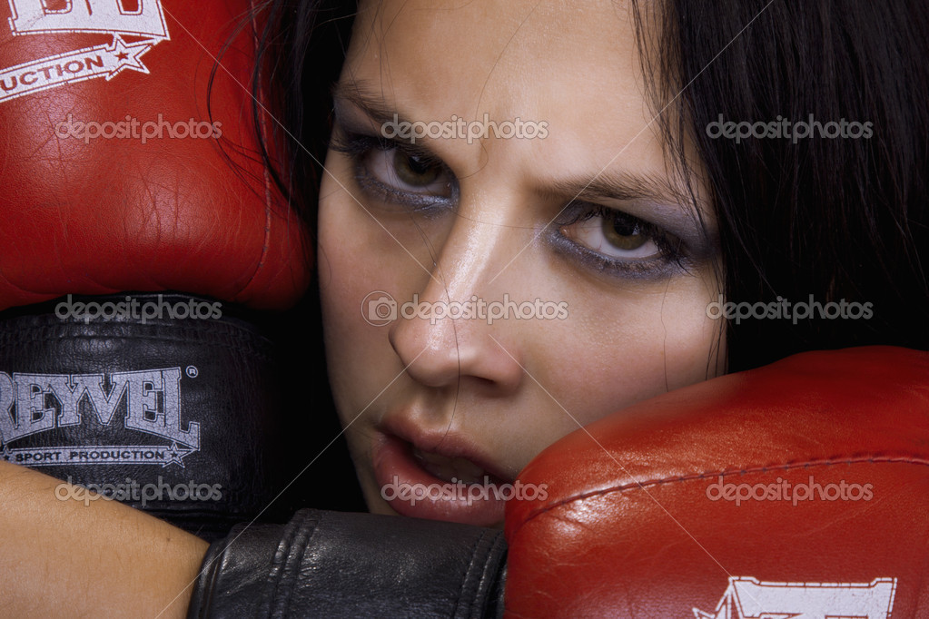 A young and fit female fighter posing in combat poses — Stock Photo #4749230