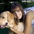 Young beautiful girl and her dog — Stock Photo
