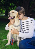 Young man with dog — Stock Photo