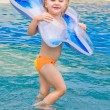 Little girl playing in blue water — Stock Photo #5205449