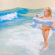 Little girl playing in blue water — Stock Photo #5205453