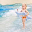 Little girl playing in blue water — Stock Photo #5205456