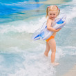 Little girl playing in blue water — Stock Photo #5205458