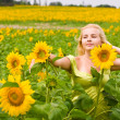 Stock Photo: Girl in sunflowers