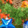 Blue star hanging from christmas tree - Stock Photo