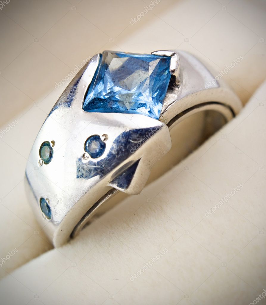Retro old silver ring with blue gem in box isolated on a white   Stock Photo #4739030