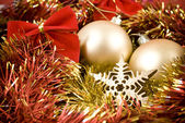 Christmas baubles and ribbons on red background — Stok fotoğraf