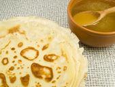 Pancakes near honey — Stock Photo