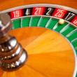 Stock Photo: Casino roulette close up with ball on number zero