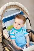 Boy in baby carriage — Stock Photo