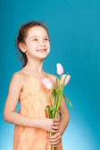 Girl with tulips — Stock fotografie