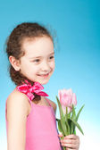 Pretty girl with flowers — Stock Photo