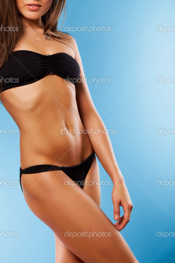 Body of attractive caucaian woman n good shape isolated on blue background in studio  Stock Photo #4736081