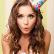 Teen blowing candles — Stockfoto