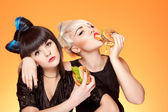 Two girls with burgers — Stock Photo
