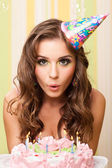 Teen blowing candles — Stock fotografie
