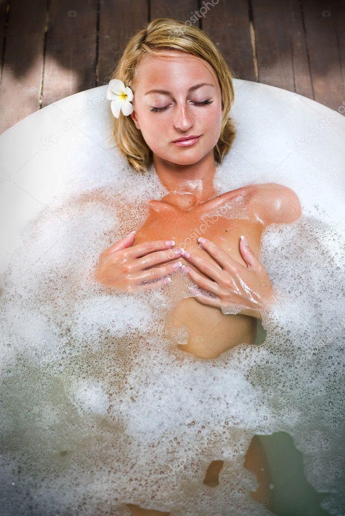 tender babe is masturbating wildly in the bathtub  339067