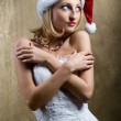 Lovely bride wearing christmas cap — Stock Photo