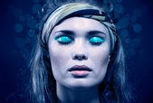 Beautiful young woman with blue make-up — Stock Photo