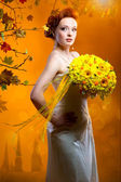 Beautiful bride with a bouquet of flowers — Stock Photo