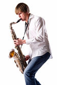 Young man playing the saxophone — Stock Photo