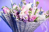 Beautiful spring flowers in a basket — Stock Photo